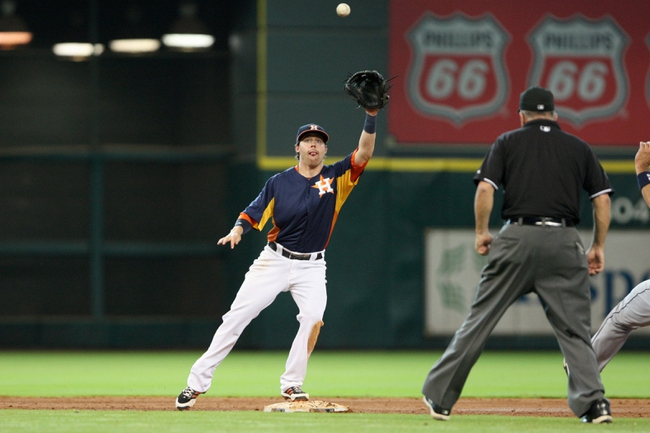 Jul 21, 2013; Houston, TX, USA; Houston Astros shortstop baseman Jake Elmore (10) fields a ground ball during the sixth inning against the Seattle Mariners at Minute Maid Park. Mandatory Credit: Troy Taormina-USA TODAY Sports