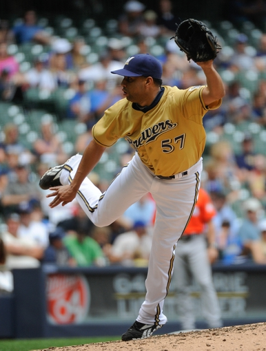 Jul 21, 2013; Milwaukee, WI, USA;  Milwaukee Brewers pitcher Francisco Rodriguez pitches in the 9th inning against the Miami Marlins at Miller Park. Mandatory Credit: Benny Sieu-USA TODAY Sports