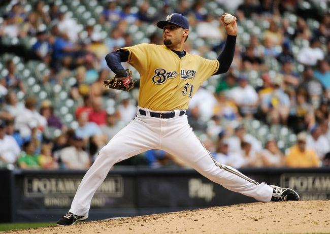 Jul 21, 2013; Milwaukee, WI, USA;  Milwaukee Brewers pitcher Mike Gonzalez pitches in the 10th inning against the Miami Marlins at Miller Park. Mandatory Credit: Benny Sieu-USA TODAY Sports