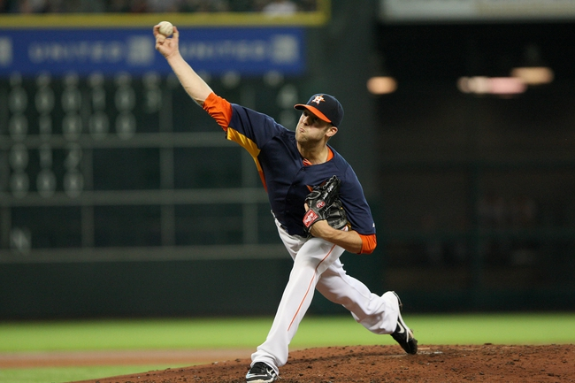 Jul 21, 2013; Houston, TX, USA; Houston Astros starting pitcher Jordan Lyles (18) pitches during the fourth inning against the Seattle Mariners at Minute Maid Park. Mandatory Credit: Troy Taormina-USA TODAY Sports