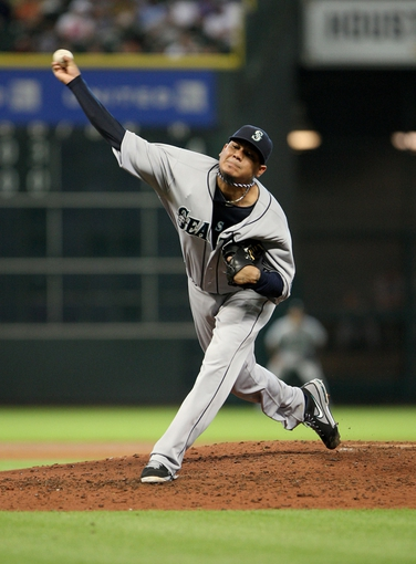 Jul 21, 2013; Houston, TX, USA; Seattle Mariners starting pitcher Felix Hernandez (34) pitches during the fourth inning against the Houston Astros at Minute Maid Park. Mandatory Credit: Troy Taormina-USA TODAY Sports