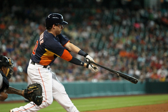 Jul 21, 2013; Houston, TX, USA; Houston Astros shortstop baseman Jake Elmore (10) gets a hit during the fifth inning against the Seattle Mariners at Minute Maid Park. Mandatory Credit: Troy Taormina-USA TODAY Sports