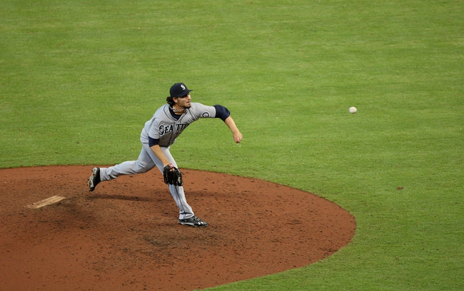 Jul 21, 2013; Houston, TX, USA; Seattle Mariners relief pitcher Bobby LaFromboise (30) pitches during the ninth inning against the Houston Astros at Minute Maid Park. Mandatory Credit: Troy Taormina-USA TODAY Sports