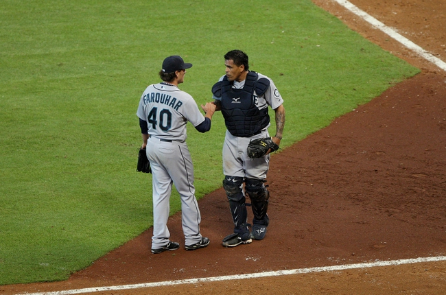 Jul 21, 2013; Houston, TX, USA; Seattle Mariners relief pitcher Danny Farquhar (40) and catcher Henry Blanco (33) celebrate after getting the final out against the Houston Astros at Minute Maid Park. The Mariners defeated the Astros 12-5. Mandatory Credit: Troy Taormina-USA TODAY Sports