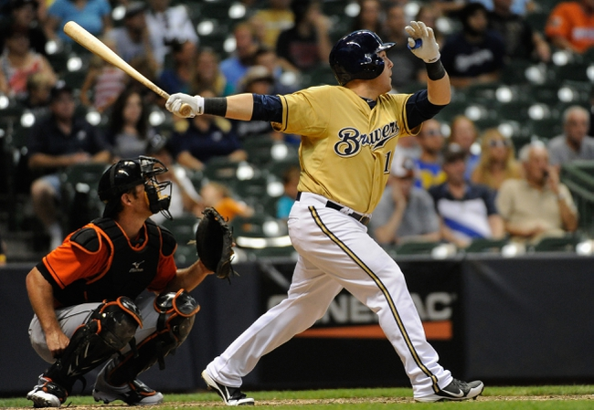 Jul 21, 2013; Milwaukee, WI, USA; Milwaukee Brewers left fielder Caleb Gindl hits a walk-off home run in the 13th inning as the Brewers beat the Miami Marlins 1-0 at Miller Park. At left is Miami Marlins catcher Rob Brantly.  Mandatory Credit: Benny Sieu-USA TODAY Sports