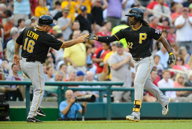 Jul 22, 2013; Washington, DC, USA; Pittsburgh Pirates center fielder Andrew McCutchen (22) is congratulated by third base coach Nick Leyva (16) after hitting a two run homer during the third inning against the Washington Nationals at Nationals Park.  Mandatory Credit: Brad Mills-USA TODAY Sports