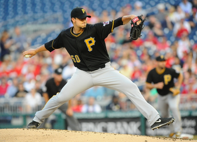 Jul 22, 2013; Washington, DC, USA; Pittsburgh Pirates starting pitcher Charlie Morton (50) throws during the first inning against the Washington Nationals at Nationals Park. Mandatory Credit: Brad Mills-USA TODAY Sports