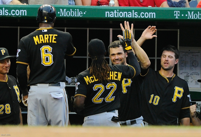 Jul 22, 2013; Washington, DC, USA; Pittsburgh Pirates center fielder Andrew McCutchen (22) is congratulated by Pittsburgh Pirates right fielder Garrett Jones (46) after hitting a two run homer during the third inning against the Washington Nationals at Nationals Park.  Mandatory Credit: Brad Mills-USA TODAY Sports