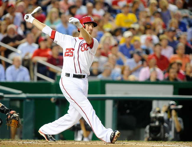 Jul 22, 2013; Washington, DC, USA; Washington Nationals first baseman Adam LaRoche (25) hits a solo homer during the fifth inning against the Pittsburgh Pirates at Nationals Park. Mandatory Credit: Brad Mills-USA TODAY Sports