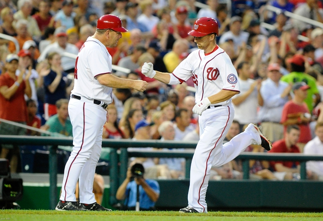 Jul 22, 2013; Washington, DC, USA; Washington Nationals first baseman Adam LaRoche (25) is congratulated by third base coach Trent Jewett after hitting solo homer during the fifth inning against the Pittsburgh Pirates at Nationals Park. Mandatory Credit: Brad Mills-USA TODAY Sports