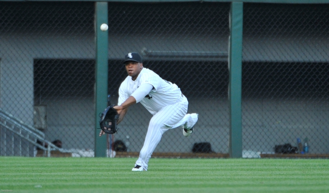 Jul 22, 2013; Chicago, IL, USA; Chicago White Sox left fielder Dayan Viciedo (24) makes a catch on Detroit Tigers center fielder Austin Jackson (not pictured) during the first inning at U.S. Cellular Field. Mandatory Credit: David Banks-USA TODAY Sports