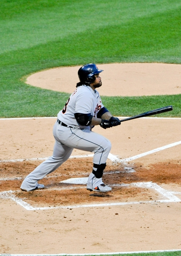 Jul 22, 2013; Chicago, IL, USA; Detroit Tigers first baseman Prince Fielder (28) hits an RBI single against the Chicago White Sox during the third inning at U.S. Cellular Field. Mandatory Credit: David Banks-USA TODAY Sports