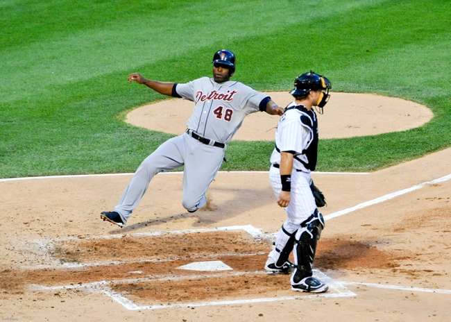 Jul 22, 2013; Chicago, IL, USA; Detroit Tigers right fielder Torii Hunter (48) scores as Chicago White Sox catcher Josh Phegley (36) stands nearby during the third inning at U.S. Cellular Field. Mandatory Credit: David Banks-USA TODAY Sports