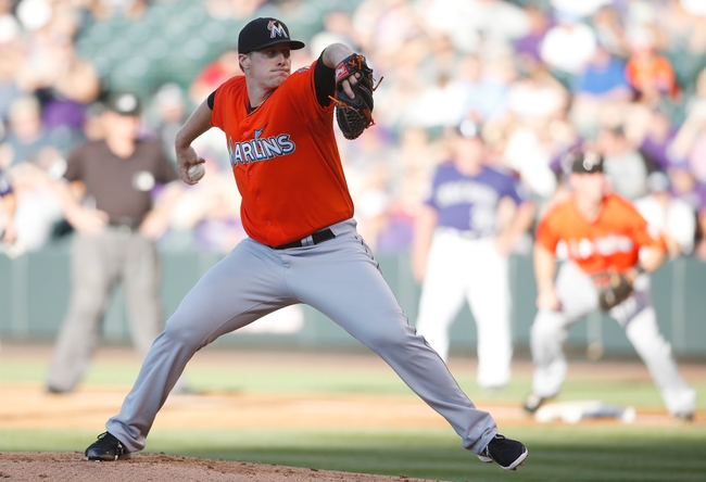 Jul 22, 2013; Denver, CO, USA; Miami Marlins pitcher Tom Koehler (34) delivers a pitch during the first inning against the Colorado Rockies at Coors Field.Mandatory Credit: Chris Humphreys-USA TODAY Sports