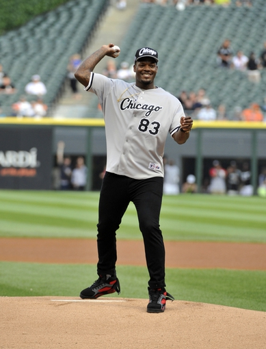 Jul 22, 2013; Chicago, IL, USA; Chicago Bears tight end Martellus Bennett (83) throws out the first pitch before the game between the Chicago White Sox and the Detroit Tigers at U.S. Cellular Field. Mandatory Credit: David Banks-USA TODAY Sports