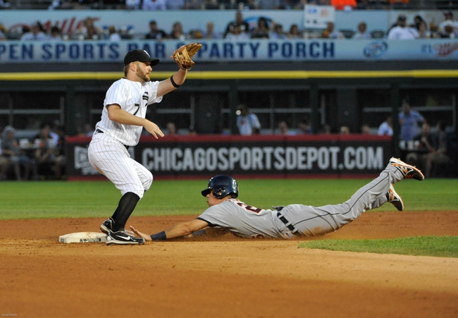 Jul 22, 2013; Chicago, IL, USA; Detroit Tigers shortstop Hernan Perez (26) steals second base as Chicago White Sox second baseman Jeff Keppinger (7) takes the throw during the fifth inning at U.S. Cellular Field. Mandatory Credit: David Banks-USA TODAY Sports