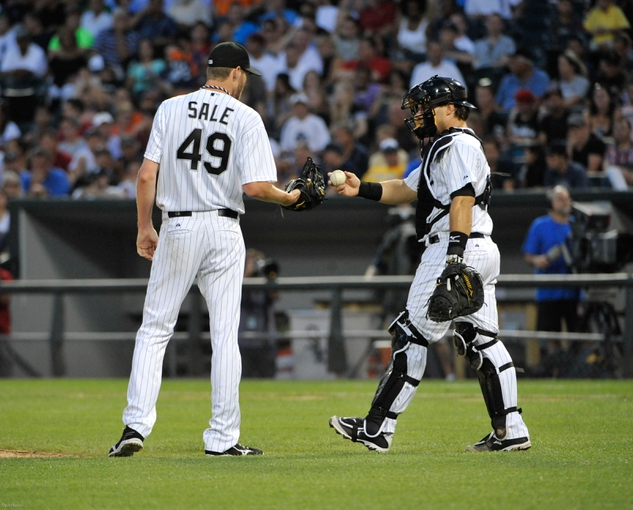 Jul 22, 2013; Chicago, IL, USA; Chicago White Sox catcher Josh Phegley (36) talks with Chicago White Sox starting pitcher Chris Sale (49) during the fifth inning against the Detroit Tigers at U.S. Cellular Field. Mandatory Credit: David Banks-USA TODAY Sports