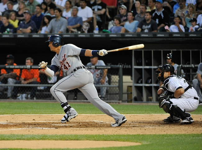 Jul 22, 2013; Chicago, IL, USA; Detroit Tigers designated hitter Victor Martinez (41) hits a two-RBI single against the Chicago White Sox during the fifth inning at U.S. Cellular Field. Mandatory Credit: David Banks-USA TODAY Sports