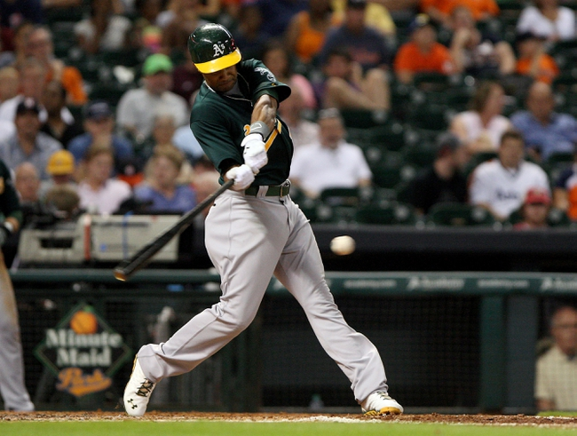 Jul 22, 2013; Houston, TX, USA; Oakland Athletics center fielder Chris Young (25) hits a triple during the fifth inning against the Houston Astros at Minute Maid Park. Mandatory Credit: Troy Taormina-USA TODAY Sports