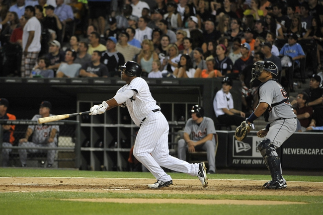 Jul 22, 2013; Chicago, IL, USA; Chicago White Sox left fielder Dayan Viciedo (24) watches his home run against the Detroit Tigers during the sixth inning at U.S. Cellular Field. Mandatory Credit: David Banks-USA TODAY Sports