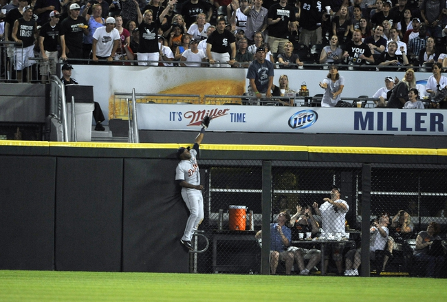 Jul 22, 2013; Chicago, IL, USA; Detroit Tigers right fielder Torii Hunter (48) can't catch a home run off the bat of Chicago White Sox left fielder Dayan Viciedo (not pictured) during the sixth inning at U.S. Cellular Field. Mandatory Credit: David Banks-USA TODAY Sports