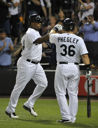 Jul 22, 2013; Chicago, IL, USA; Chicago White Sox left fielder Dayan Viciedo (24) is greeted by catcher Josh Phegley (36) after hitting a home run against the Detroit Tigers during the sixth inning at U.S. Cellular Field. Mandatory Credit: David Banks-USA TODAY Sports