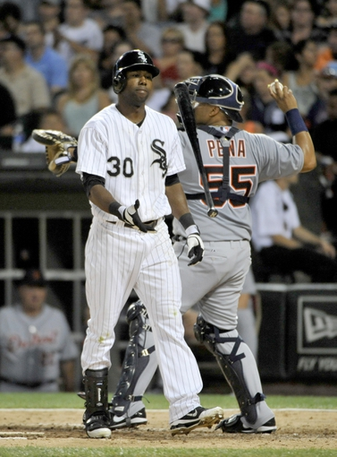 Jul 22, 2013; Chicago, IL, USA;  Chicago White Sox center fielder Alejandro De Aza (30) reacts after striking out against the Detroit Tigers during the sixth inning at U.S. Cellular Field. Mandatory Credit: David Banks-USA TODAY Sports