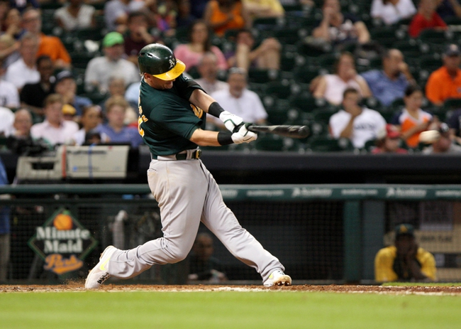 Jul 22, 2013; Houston, TX, USA; Oakland Athletics third baseman Josh Donaldson (20) singles during the sixth inning against the Houston Astros at Minute Maid Park. Mandatory Credit: Troy Taormina-USA TODAY Sports
