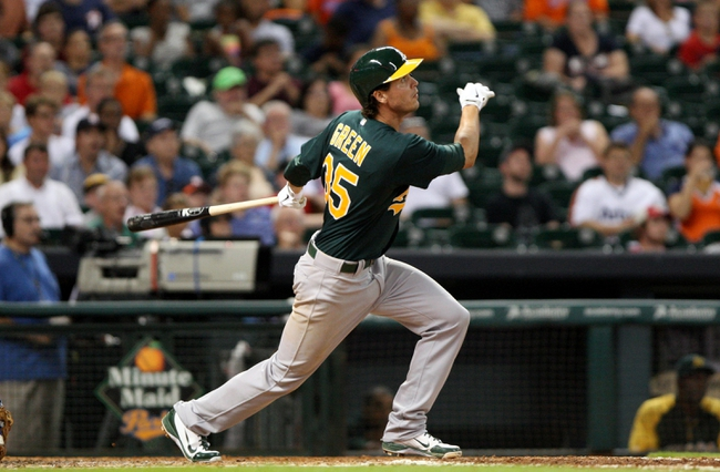 Jul 22, 2013; Houston, TX, USA; Oakland Athletics second baseman Grant Green (35) drives in a run with a sacrifice fly during the sixth inning against the Houston Astros at Minute Maid Park. Mandatory Credit: Troy Taormina-USA TODAY Sports