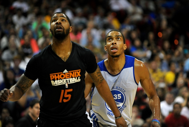 Jul 22, 2013; Las Vegas, NV, USA; Phoenix Suns forward Marcus Morris (left) and Golden State Warriors forward Lance Goulbourne watch as a free throw attempt goes toward the basket during the NBA Summer League Championship game at the Thomas and Mack Center. Mandatory Credit: Stephen R. Sylvanie-USA TODAY Sports