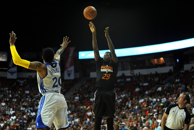 Jul 22, 2013; Las Vegas, NV, USA; Phoenix Suns guard Archie Goodwin lets a shot go over the defense of Golden State Warriors guard Kent Bazemore during the NBA Summer League Championship game at the Thomas and Mack Center. Mandatory Credit: Stephen R. Sylvanie-USA TODAY Sports