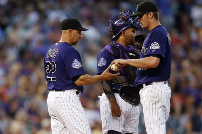 Jul 22, 2013; Denver, CO, USA; Colorado Rockies pitcher Drew Pomeranz (right) is taken out of the game by manager Walt Weiss (22) during the fifth inning against the Miami Marlins at Coors Field. Mandatory Credit: Chris Humphreys-USA TODAY Sports