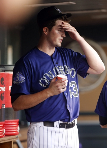 Jul 22, 2013; Denver, CO, USA; Colorado Rockies pitcher Drew Pomeranz (13) reacts in the dugout after being taken out of the game during the fifth inning against the Miami Marlins at Coors Field. Mandatory Credit: Chris Humphreys-USA TODAY Sports