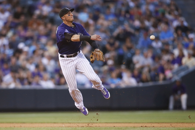 Jul 22, 2013; Denver, CO, USA; Colorado Rockies shortstop Troy Tulowitzki (2) fields a ground ball during the fifth inning against the Miami Marlins at Coors Field. Mandatory Credit: Chris Humphreys-USA TODAY Sports