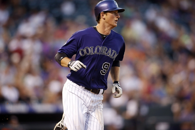Jul 22, 2013; Denver, CO, USA; Colorado Rockies second baseman DJ LeMahieu (9) runs to first base on a single during the fifth inning against the Miami Marlins at Coors Field. Mandatory Credit: Chris Humphreys-USA TODAY Sports