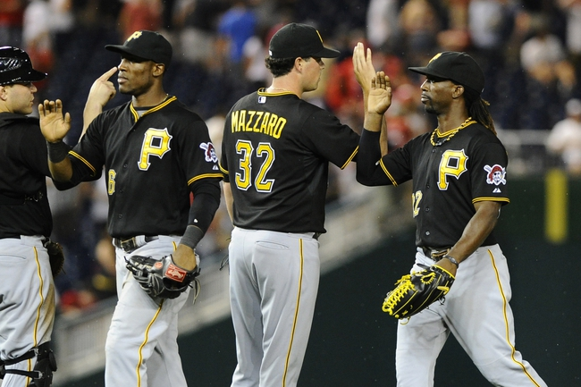 Jul 22, 2013; Washington, DC, USA; Pittsburgh Pirates center fielder Andrew McCutchen (22) congratulates relief pitcher Vin Mazzaro (32) after recording the final out against the Washington Nationals at Nationals Park.  Mandatory Credit: Brad Mills-USA TODAY Sports