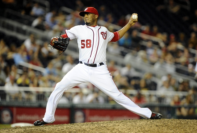 Jul 22, 2013; Washington, DC, USA; Washington Nationals relief pitcher Fernando Abad (58) throws during the ninth inning against the Pittsburgh Pirates at Nationals Park. Mandatory Credit: Brad Mills-USA TODAY Sports