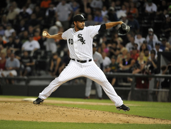 Jul 22, 2013; Chicago, IL, USA; Chicago White Sox relief pitcher Ramon Troncoso (40) pitches against the Detroit Tigers during the ninth inning at U.S. Cellular Field. Mandatory Credit: David Banks-USA TODAY Sports