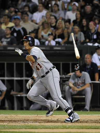Jul 22, 2013; Chicago, IL, USA; Detroit Tigers designated hitter Victor Martinez (41) hits a single against the Chicago White Sox during the eighth inning at U.S. Cellular Field. Mandatory Credit: David Banks-USA TODAY Sports