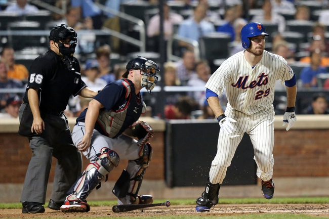 Jul 22, 2013; New York, NY, USA;   New York Mets first baseman Ike Davis (29) singles to right allowing a runner to score during the fourth inning against the Atlanta Braves at Citi Field.  Atlanta Braves won 2-1.  Credit: Anthony Gruppuso-USA TODAY Sports