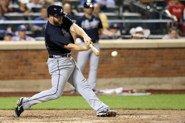 Jul 22, 2013; New York, NY, USA;  Atlanta Braves catcher Evan Gattis (24) singles to left during the seventh inning against the New York Mets at Citi Field.  Atlanta Braves won 2-1.  Credit: Anthony Gruppuso-USA TODAY Sports