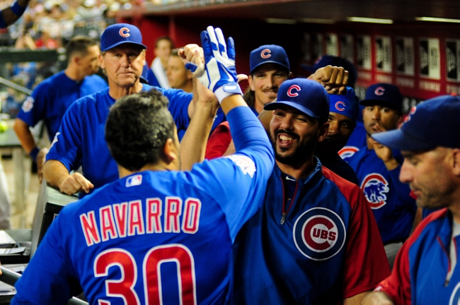 Jul 22, 2013; Phoenix, AZ, USA; Chicago Cubs catcher Dioner Navarro (30) celebrates with teammates after hitting a solo home run during the second inning against the Arizona Diamondbacks at Chase Field. Mandatory Credit: Matt Kartozian-USA TODAY Sports
