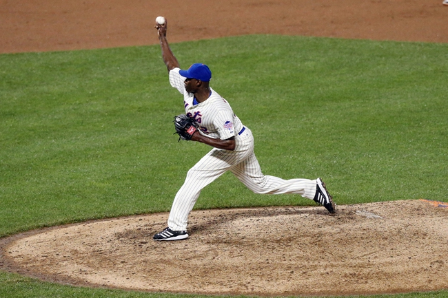 Jul 22, 2013; New York, NY, USA;  New York Mets relief pitcher LaTroy Hawkins (32) pitches during the eighth inning against the Atlanta Braves at Citi Field.  Atlanta Braves won 2-1.  Credit: Anthony Gruppuso-USA TODAY Sports