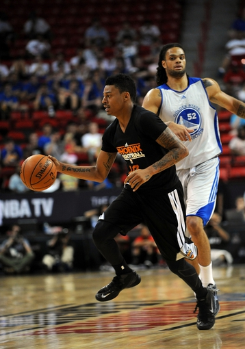 Jul 22, 2013; Las Vegas, NV, USA; Phoenix Suns guard Diante Garrett dribbles the ball away from Golden State Warriors center Gary McGhee during the NBA Summer League Championship game at the Thomas and Mack Center. Mandatory Credit: Stephen R. Sylvanie-USA TODAY Sports