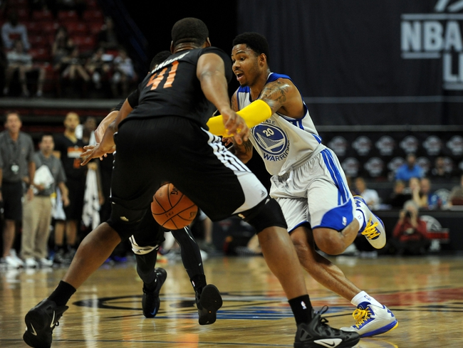 Jul 22, 2013; Las Vegas, NV, USA; Golden State Warriors guard Kent Bazemore looks to dribble past Phoenix Suns center Arinze Onuaku during the NBA Summer League Championship game at the Thomas and Mack Center. Golden State won the game 91-77 to remain undefeated during the Summer League games. Mandatory Credit: Stephen R. Sylvanie-USA TODAY Sports