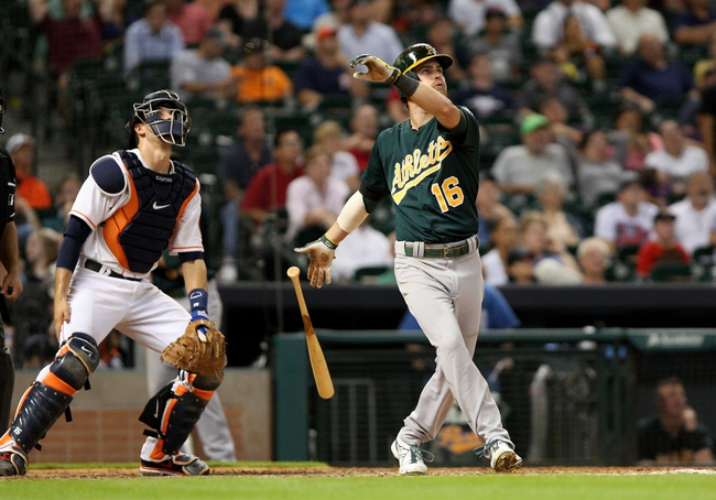 Jul 22, 2013; Houston, TX, USA; Oakland Athletics right fielder Josh Reddick (16) hits a home run during the eighth inning against the Houston Astros at Minute Maid Park. Mandatory Credit: Troy Taormina-USA TODAY Sports