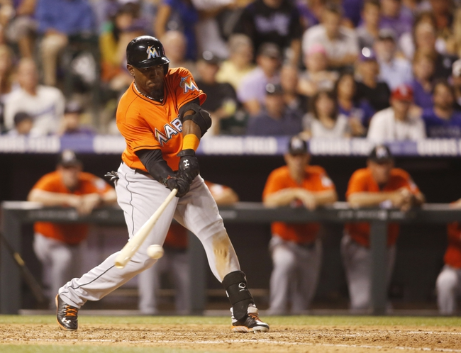 Jul 22, 2013; Denver, CO, USA; Miami Marlins center fielder Marcell Ozuna (48) hits a single during the eighth inning against the Colorado Rockies at Coors Field. Mandatory Credit: Chris Humphreys-USA TODAY Sports