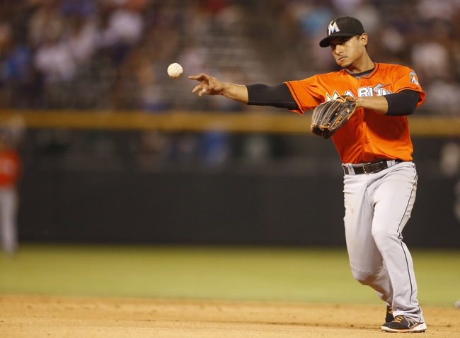 Jul 22, 2013; Denver, CO, USA; Miami Marlins second baseman Donovan Solano (17) fields a ground ball during the eighth inning against the Colorado Rockies at Coors Field. Mandatory Credit: Chris Humphreys-USA TODAY Sports