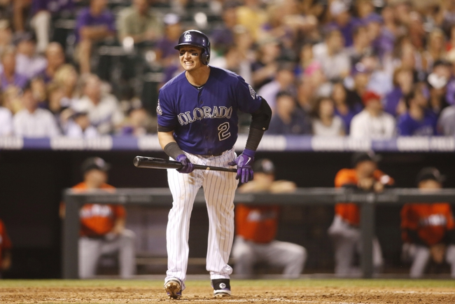 Jul 22, 2013; Denver, CO, USA; Colorado Rockies shortstop Troy Tulowitzki (2) reacts during the eighth inning against the Miami Marlins at Coors Field. Mandatory Credit: Chris Humphreys-USA TODAY Sports