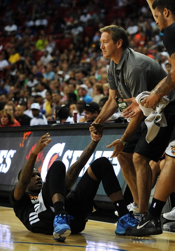 Jul 22, 2013; Las Vegas, NV, USA; Phoenix Suns head coach Jeff Hornacek helps up Suns guard Archie Goodwin after he was fouled on a play by the Golden State Warriors in the NBA Summer League Championship game at the Thomas and Mack Center. Golden State won the game 91-77 to remain undefeated during the Summer League games. Mandatory Credit: Stephen R. Sylvanie-USA TODAY Sports